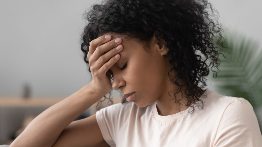 young lady with migraine